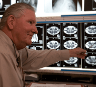 Spinal surgeon examining MRIs
