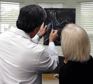 a spine surgeon with his patient
