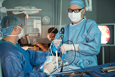 spine surgeons performing a discectomy