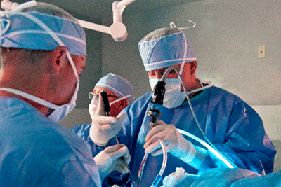 Doctors perform lumbar spine surgery in the operating room