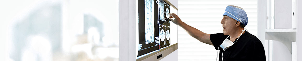 Dr Alfred Bonati reading a spinal MRI